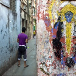 Cricket in the alley and mural of goddess Kali, Near Shyambazar, 2011